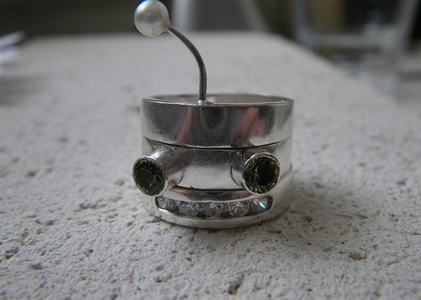 Sterling silver Robot stacking ring with channel set cubic zirconia, peridot, and pearl.