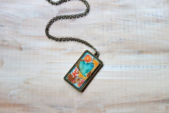 What a stunning piece of intricate art pendant! Fabric Mosaic Teal Heart in Orange Field by NariDesignPot on Etsy.