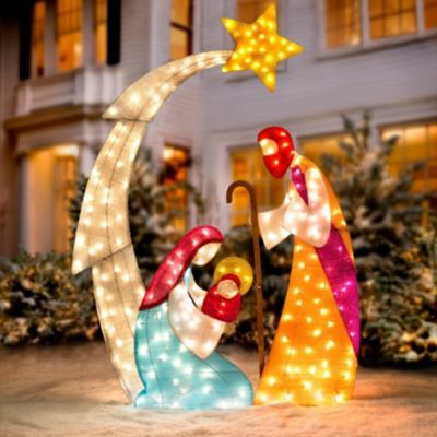 """Tinsel Fabric Shimmery Lighted Nativity Scene ,,,  stands over 6' high... This outdoor Christmas display stands an impressive 73"""" high and is lit by 210 clear incandescent lights ... Folds down for easy storage."""
