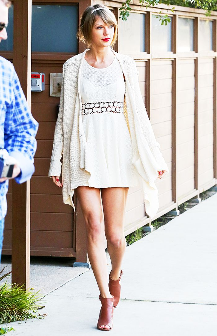 Taylor Swift in a white eyelet dress and brown heels