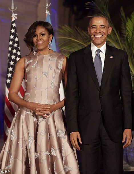 Obama and Michelle attend a state dinner in Buenos Aires...