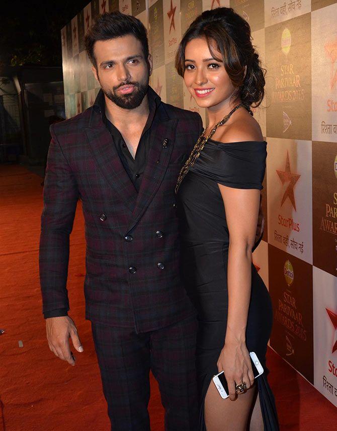 Pavitra Rishta lead pair and real life couple Rithvik Dhanjani and Asha Negi pose for pictures.