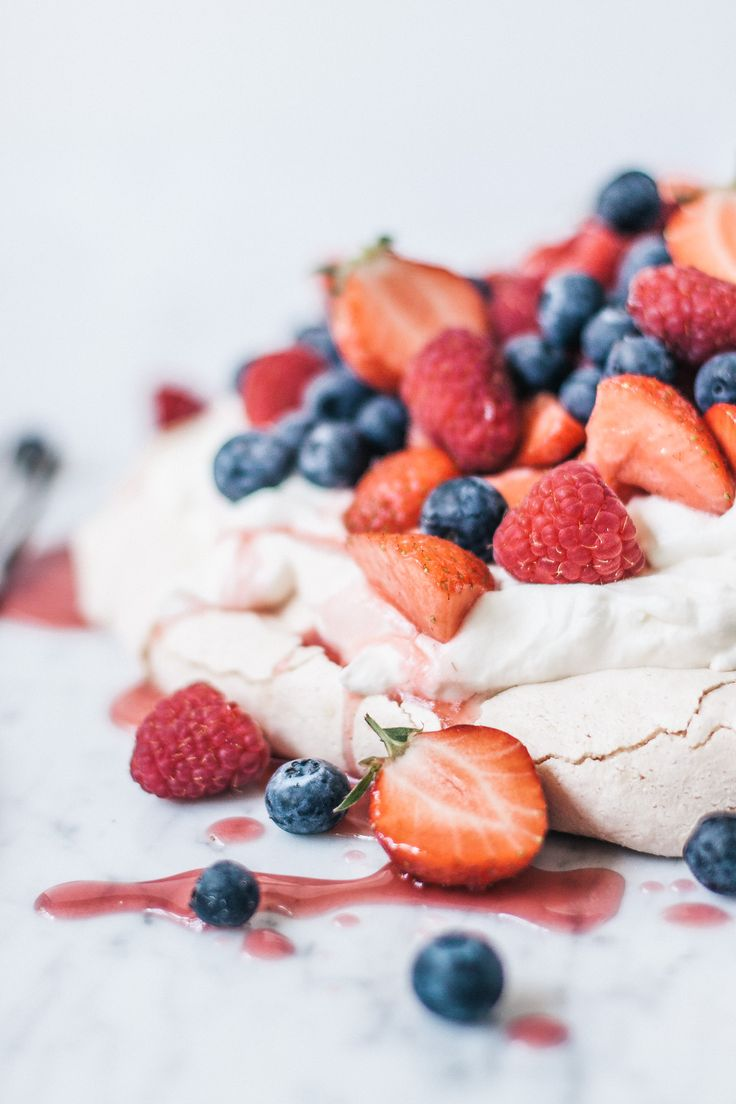... fresh summer pavlova with whipped cream fruits ...