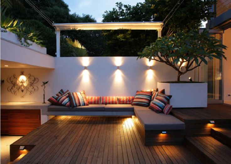 Beautifully lit seating area in the courtyard.