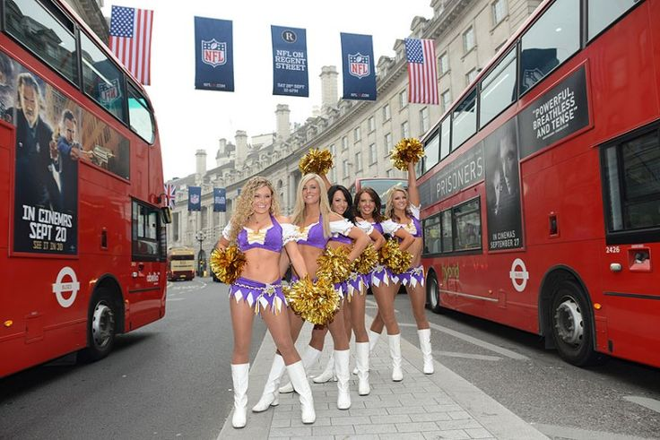 Minnesota Vikings cheerleaders stand in Regent Street in London. The Minnesota Vikings will play the Pittsburgh Steelers at Wembley Stadium ...