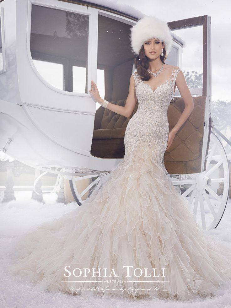 Sophia Tolli - Y21502 � Blake - Misty tulle wedding dress with ruffles and hand-beading, fit and flare gown with illusion tulle slight cap sleeves,V-neckline that conceals a satin sweetheart bodice, sheer tulle back with plunging neckline framed with lace appliqu�s,�back zipper trimmed with diamante buttons and chapel length train. Also available with a 3� raised back neckline as Y21502HB. Click to view more�tulle wedding dresses.Sizes: 0 � 28Colors: Blush Ivory, Ivory, White