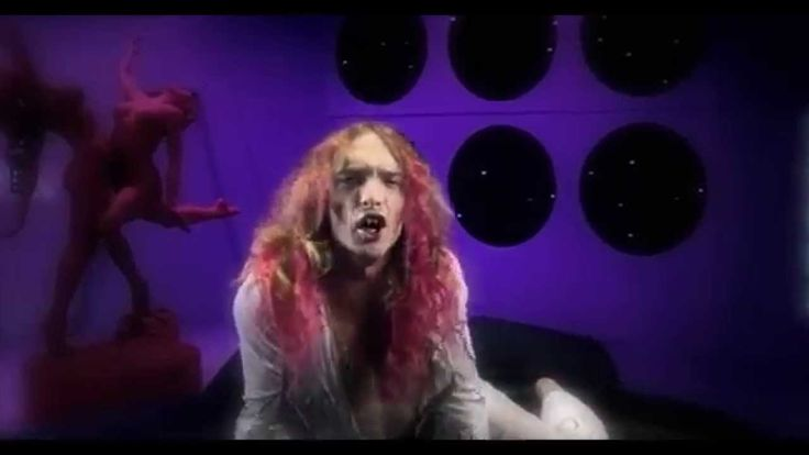 The Darkness - I Believe In A Thing Called Love (Official Music Video)  | I love this song and the music video is awesome!  It's like the 80's threw up.  Also, is just me, or does the lead singer look kinda like James Franco?