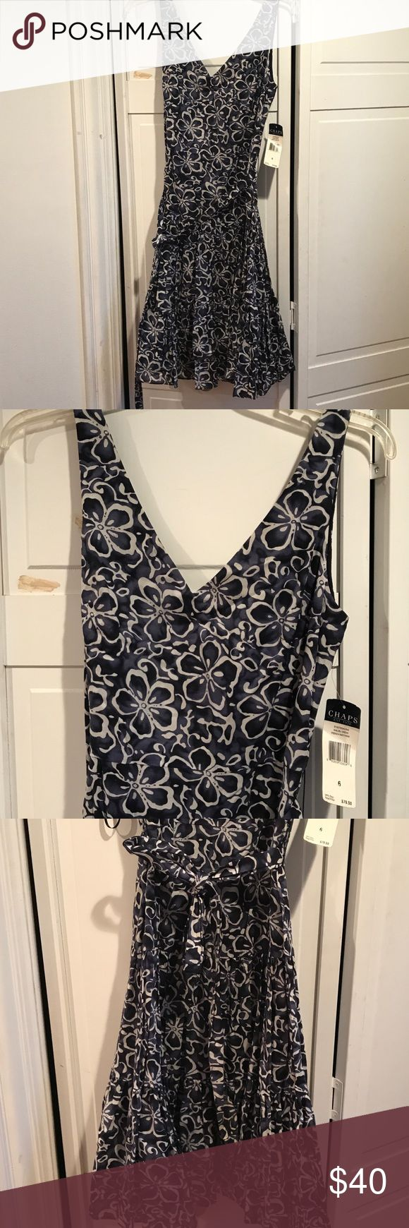 Chaps Navy and White Floral dress Blue and white floral dress. Very fitted on top but no cleavage and flows very lovely around the legs. Demure but very flattering dress for any occasion Chaps Dresses Midi