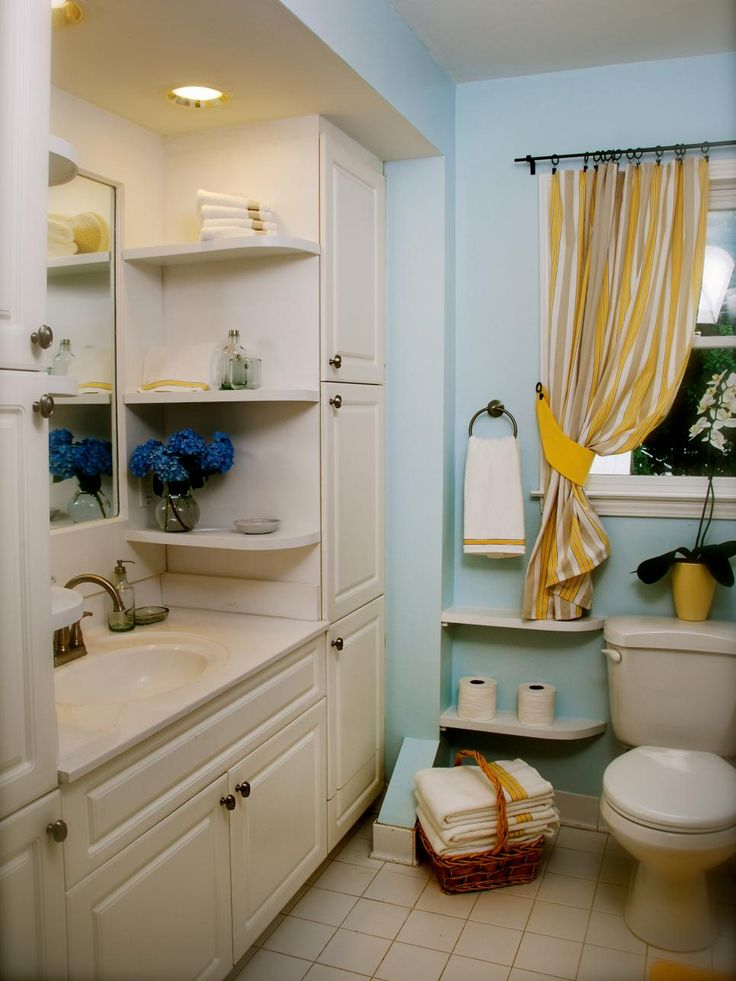 Small space doesn't have to mean zero storage. This bathroom vanity is surrounded by spacious cabinets and narrow display shelves beside the toilet and mirror for easy-to-reach necessities.