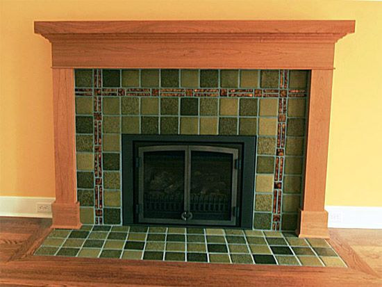 simplistic yet beautiful very nice fireplace mantel with unique tile surround