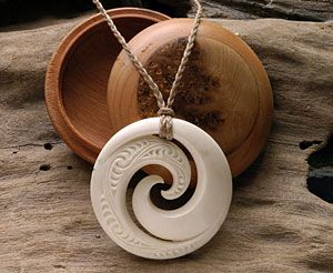 Maori Koru necklace carving made from deer antler. www.boneart.co.nz , with a nice wood case...
