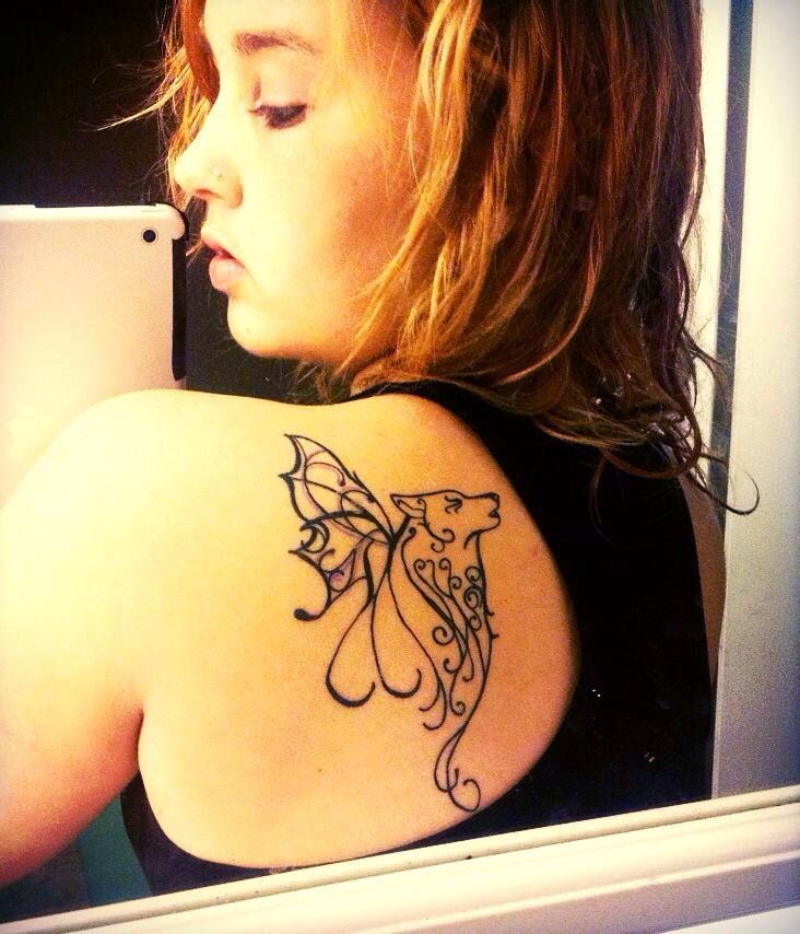 Lupus wolf/ butterfly tattoo.