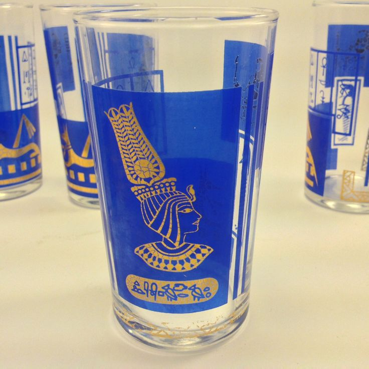 6 midcentury bar drinking bar glasses Ancient Egyptian theme with queen carsophagus dog and bird man and hieroglyphics in blue and gold by BonBibelots on Etsy https://www.etsy.com/listing/290589767/6-midcentury-bar-drinking-bar-glasses