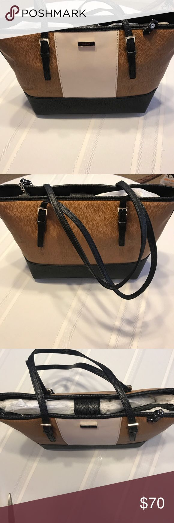 Nine West women's multi colored handbag Nine West women's multi colored handbag.  This is a elegant hand bag with neutral colors.  Well made and can be worn for any occasion. Nine West Bags Shoulder Bags