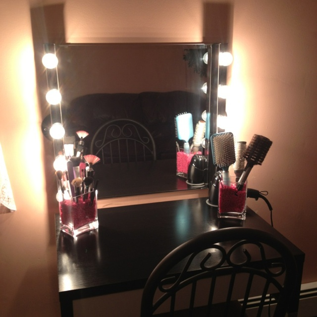 My makeup vanity for under $150!!! Desk $50 Rectangle makeup holders $3 each Vanity lights $15 each (called musik) (all the above bought in ikea) The pink rocks I bought at a fish store for $5 Light bulbs I bought at home Depot-  $13 for 4 boxes  The plug ins that connect to the lights you can also buy in home Depot but I'm not sure how Much they go for since I already had Some.... Hope this helps for Those of you looking to make this!
