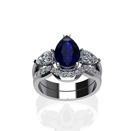 Our favourite!!! Pear shaped blue sapphire with pear cut diamonds on the sides and a shaped wedding band with round brilliant cut diamonds. www.jewellerybyliamross.com