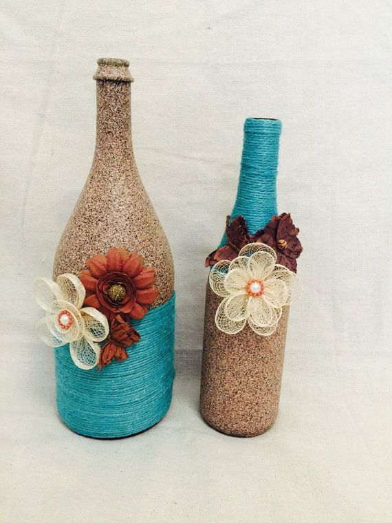 Stone and teal rustic wine bottles with flower and butterfly accents for home or wedding