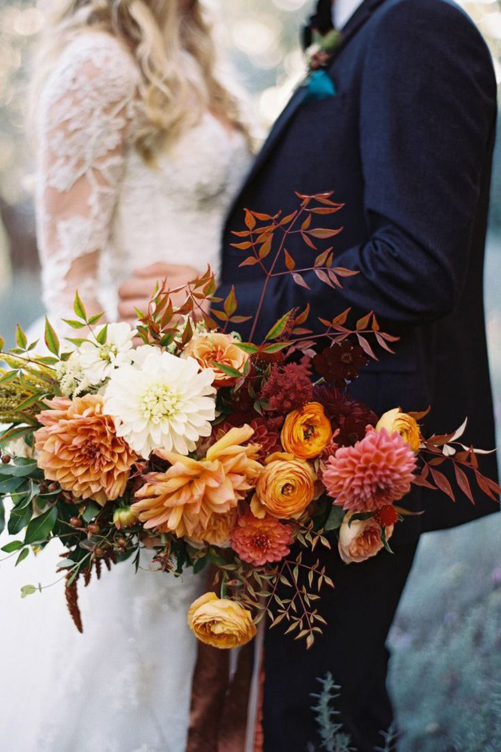 Fall bridal bouquet of rust, gold, burgundy and orange featuring dahlias and ranunculus ~ we ❤ this! moncheribridals.com