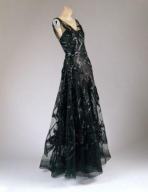Evening dress, 1938  Madeleine Vionnet (French, 1876–1975)  Black silk satin and black silk net embroidered with black sequins