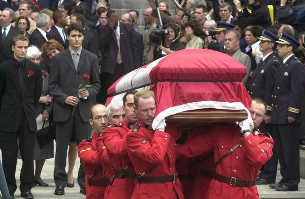 Justin and Sacha Trudeau watch as their father's remains are carried from the Notre Dame Basilica on Oct. 3, 2000.