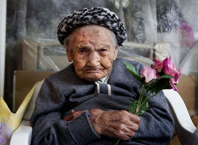 Amalia Lopez, who is 114-years-old, poses for a portrait inside her home on Mothers Day in Mexico City, on May 10, 2013. Lopez was honored by the city for being the oldest living woman in Mexico City. Lopez has survived her four children, and has 15 grandchildren and three great-grandchildren. Lopez was born on July 10, 1898, and will turn 115 this July 10. (Photo by Eduardo Verdugo/Associated Press) http://avaxnews.net/fact/The_Week_in_Pictures_May_6-May_10_2013.html #avaxnews.net