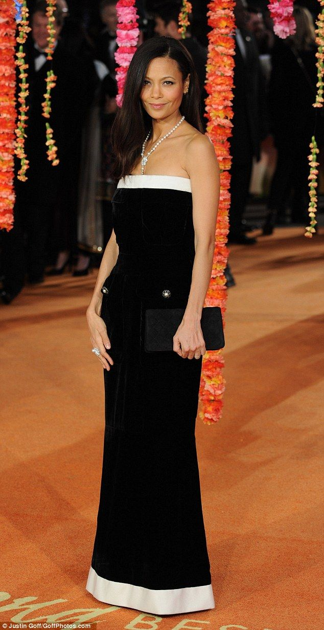 Classic in Chanel: Thandie opted for a black evening gown with white detailing and pearls around her neck