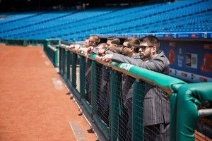 The groomsmen in the dugout at the Phillies stadium, Citizens Bank Park