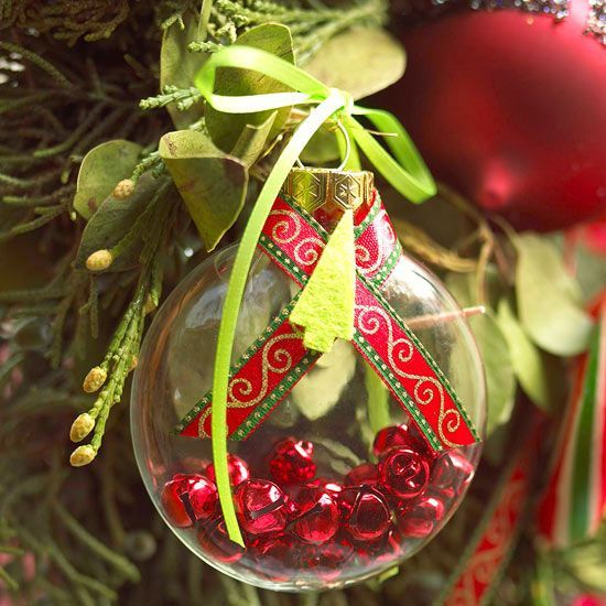 Jingle Bell Christmas Tree Ornaments    Fill a clear ornament with small red bells. Wrap ribbon around the top of the ornament and glue the long tails in place. For an extra touch, tie ribbon through the hanger and glue a felt Christmas tree to the center of the crossed ribbon tails.