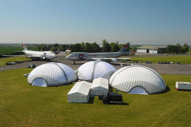 Inflatable dome structures assembled for an event. #EvolutionDome #InflatableStructure #TemporaryStructures  #Airport #Planes #EventStructures #EventProduction #EventIdeas #Corporate #EventSpace #Popup #Venue #AlternativeMarquee