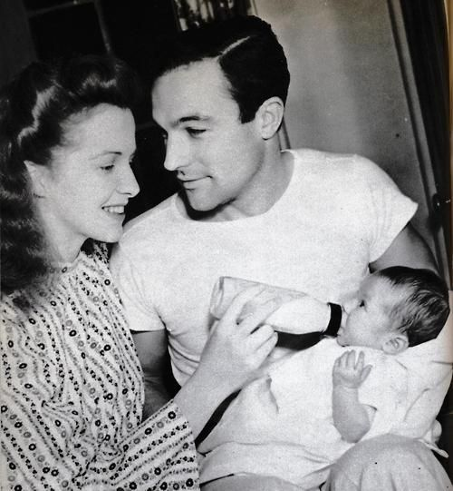 Gene Kelly.  Love this picture.  My God look at how he's looking at her.