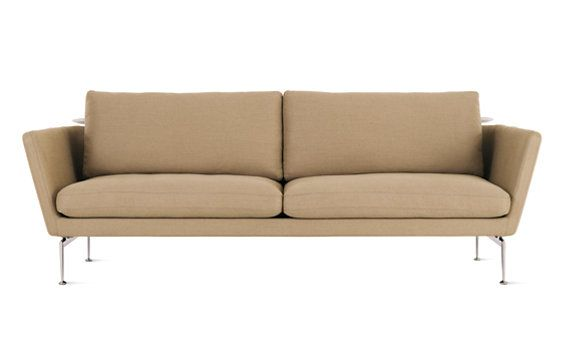 """The sofa in the living room is the Suita 92"""" Sofa with Tray-Laser designed by Antonio Citterio for Vitra"""