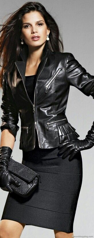 Woman Is Wearing a Basic Black Dress & Basic Black Leather Jacket w. Ruffle Detailing @ the Hips and Forearm Length Leather Gloves.