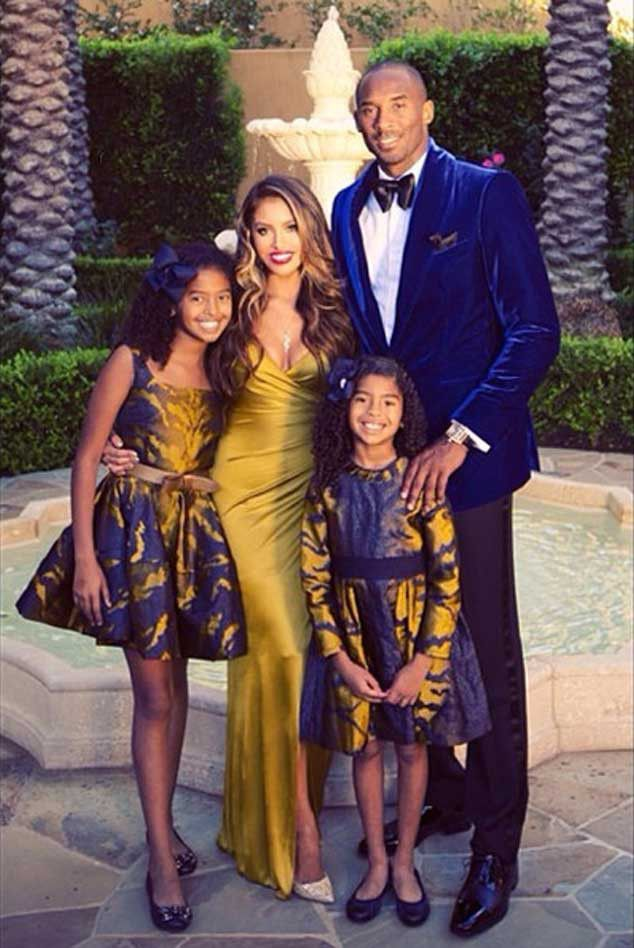 2014 | Kobe & Vanessa Bryant from Celebrity Christmas Cards  The basketball star and his beautiful family rep Lakers' colors for their photo.