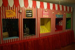 DIY Carnival Game Booths.  Made from cardboard boxes and covered with striped, plastic tablecloths. by wanda
