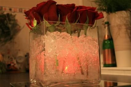 Great idea for Valentine's Day:  Square vase with water gem and a Battery light inside the Vase of Roses