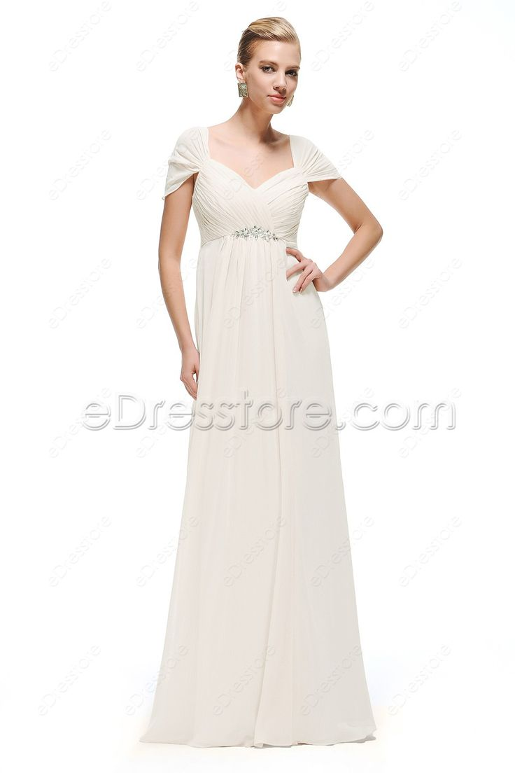 The chiffon wedding dress features sweetheart neckline, cap sleeves can be worn in three different ways, straps, off the shoulder or as cap sleeves, hand sewn crystals at empire waist, A line floor length skirt.