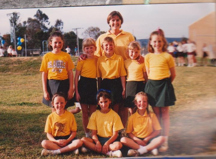 Netball pic of Pam as coach and Kim front row right