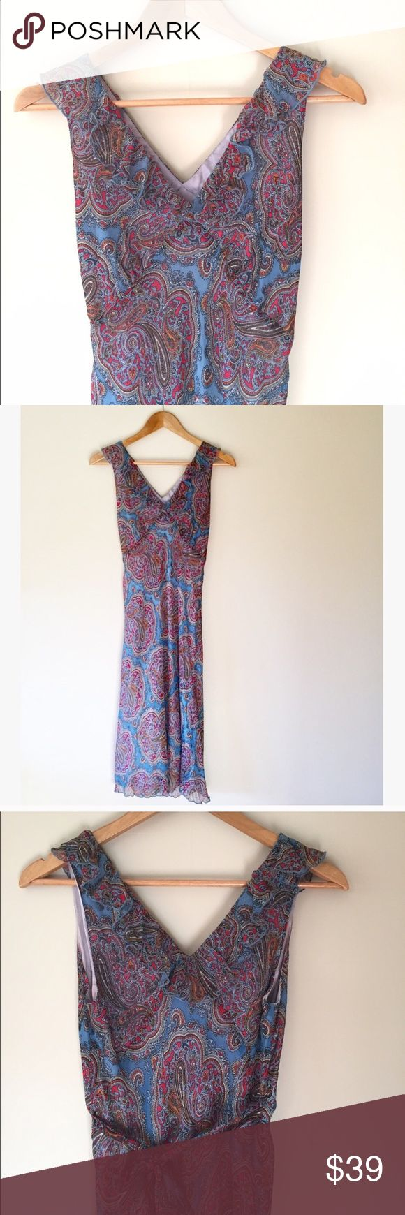 """Anna Sui Paisley Silk Midi Dress This gorgeous Anna Sui dress is versatile for all seasons. Fully lined. Shell is 100% silk, lining is 100% acetate.   44"""" long  17"""" armpit to armpit   No trades, offers welcome! Anna Sui Dresses Midi"""