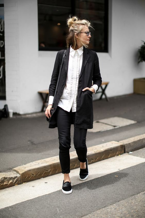 black blazer-style jacket, white embellished button-down, black straight-leg pants, black slip-ons