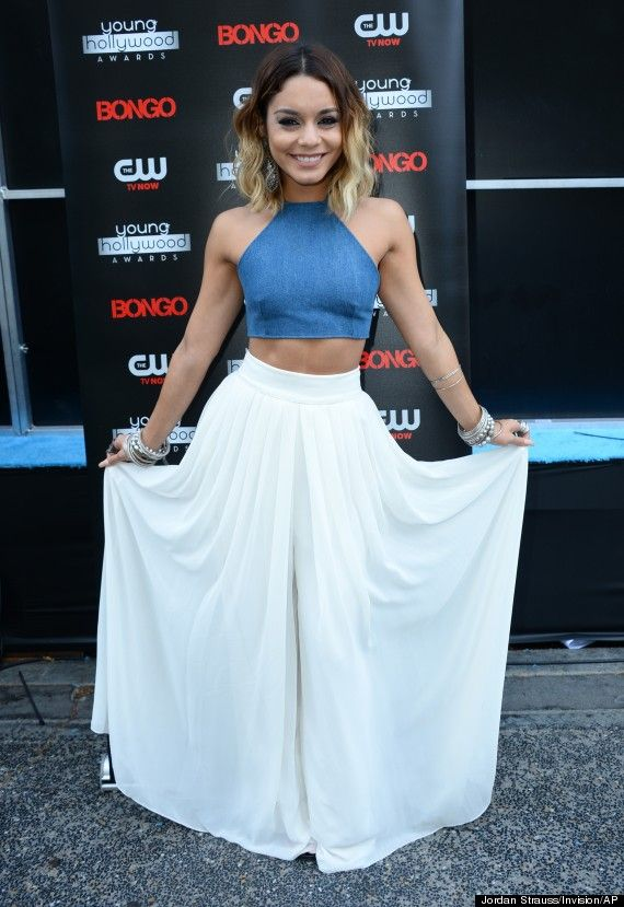 Vanessa Hudgens was honored with the Trendsetter of the Year award at the Young Hollywood Awards in Los Angeles on July 27, and her trendy outfit definitely lived up to the title. The 25-year-old rocked a blue Bongo crop top and flowy, high-waisted white pants. She accessorized the effortless look with her signature boho bangles, silver accent rings and a feathery white clutch.