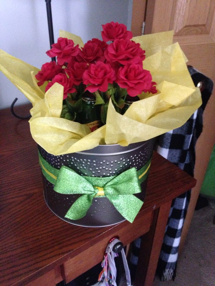 Quick and easy Beer Bouquet Beer, tissue paper, ribbon, flowers, and a container