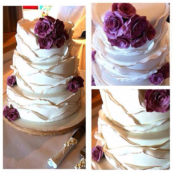Envelope frills with an edible gold trim and beautiful iced roses...