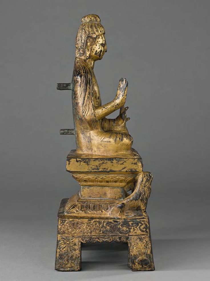 Buddha In Abhaya-Mudra Seated On A Lion Throne