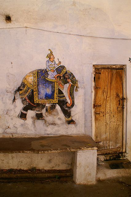 A faded elephant painted onto the wall in a side alley - Udaipur, India. Angus MacRae