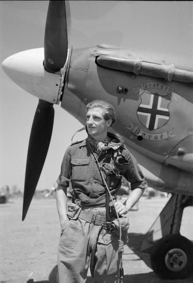 ROYAL AIR FORCE OPERATIONS FAR EAST 1941-1945  Squadron Leader G A Butler, of Grimsby, Lincolnshire, Commanding Officer of No. 11 Squadron RAF, stands by the nose of his Hawker Hurricane Mark IIC at Sinthe, Burma. Note Butler's personal insignia on the nose of the aircraft.