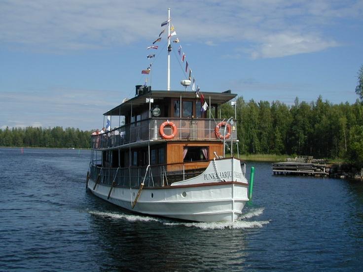 Cruising on beautiful lake Saimaa. Savonlinna, Finland.