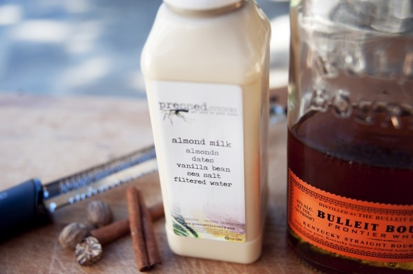 Bourbon Almond Milk Punch   Using a high-rye bourbon like Bulleit means a less cloyingly sweet flavor. Combined with luscious almond milk, and a touch of spice, this milky punch is surprisingly refreshing.     1 bottle almond milk   4 oz bourbon   1/4 tsp cinnamon   1/4 tsp nutmeg   1 tablespoon agave nectar     Shake all of the ingredients and pour over ice and top with some nutmeg.: Press Juiceri, Almond Milk, Bourbon Almonds, Oz Bourbon, Agaves Nectar, Milk Punch, Sweet Flavored, Almonds Milk, Sangria Recipes