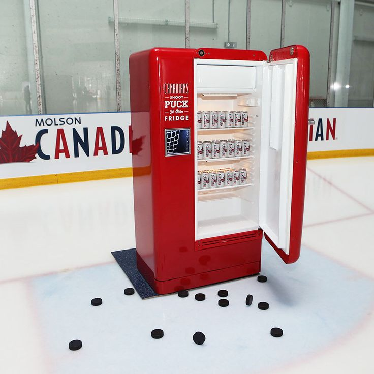 The Slap Shot Fridge, the third instalment in the Molson Beer Fridge series, honouring the great Canadian love for hockey. Participants shoot pucks at a small opening in the face of the fridge. An accurate shot initiates a 100dB air horn and the fridge door opens automatically, rewarding the best hockey snipers with Molson Canadian beer, swag, and tickets to major hockey games. The fridge is made of carbon fiber and Kevlar, ensuring its durability.