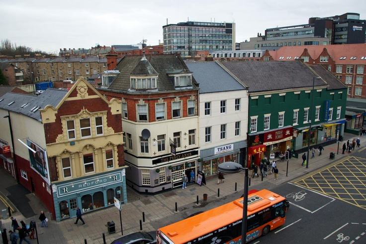 February 2013 - Looking from the top of the Haymarket multi-storey towards the row of shops on Percy Street. Some surprisingly strong contenders still hanging on to their retail prowess over ten years on...