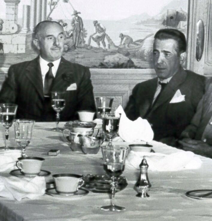 Humphrey Bogart having lunch with original Warner Brothers studio head, Jack Warner. - photo courtesy of Humphrey Bogart Estate.